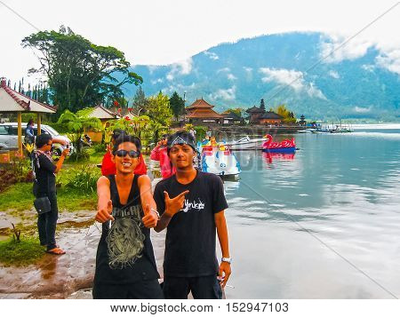 Bratan lake Indonesia - April 17 2012: The local people posing at Pura Ulan Danu Bratan Water Temple in Bali island Indonesia