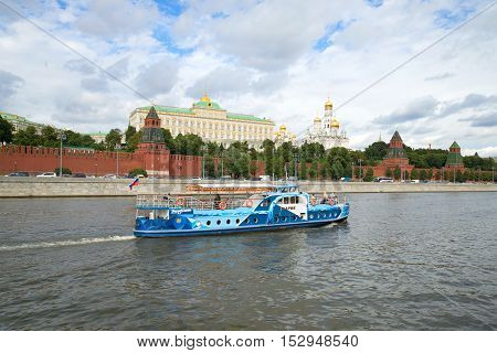 MOSCOW, RUSSIA - SEPTEMBER 07, 2016: The walking excursion motor ship on the Moskva River against the background of the Kremlin. Tourist landmark