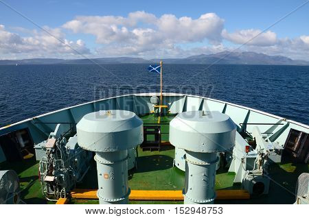 The bow of a ferry boat travelling towards the Isle of Arran