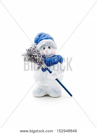 Figurine cheerful snowman holding a broom on a white background.