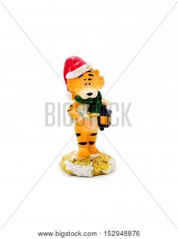 Orange statuette of a tiger with dollars isolated on a white background. Holidays gift.