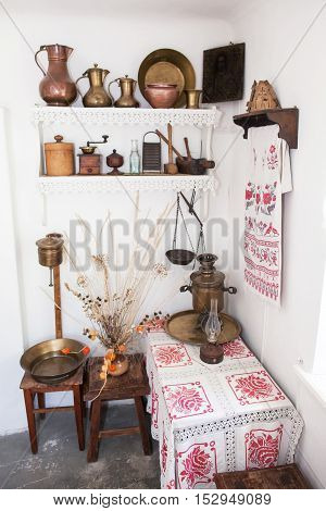 Old russian interior. Rural interior. Rural tenor of life. Old Russian furniture of kitchen. Rural furniture of kitchen. An interior of kitchen in the village.
