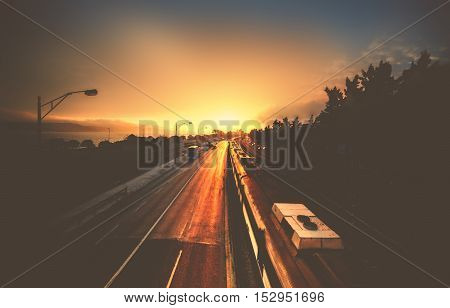 Beautiful landscape scene and sunrise above railway road from a bridge dark colors