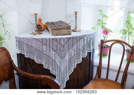 Old russian interior. Rural interior. Rural tenor of life. Rural furniture of kitchen. Interior in the village. Candlesticks on a dresser.