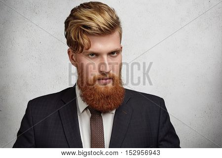 Close Up Portrait Of Handsome Young Corporate Worker With Stylish Haircut And Thick Beard Wearing El