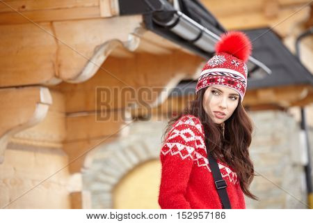 A woman resting after a winter sports on the terrace of the house