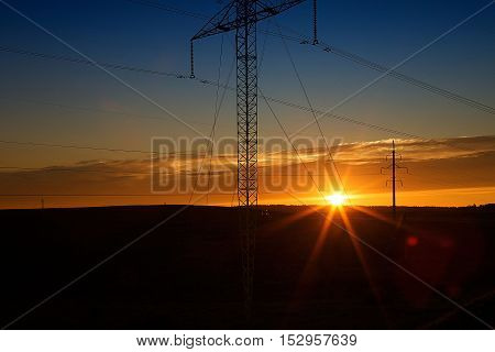 Decrease in the area and a power line on a sunset