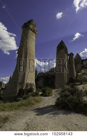 Vertical rock formations at Love valley in Turkey in the afternoon sunlight