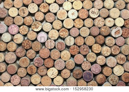 many different used wine corks in the background