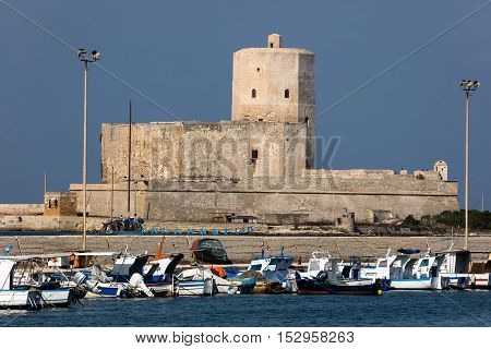 TRAPANI ITALY - AUGUST 11 2016: Castle of Colombaia located on a small island in front of the Trapani's harbor. This is one of the oldest monuments in the city tracing its origins to antiquity.