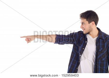 Portrait of a young handsome man pointing at something. Isolated white background.