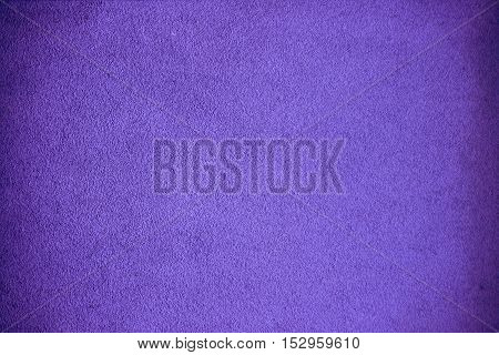 A grainy grungy background in the color purple.