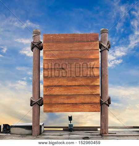 wooden signboard on sky background . .