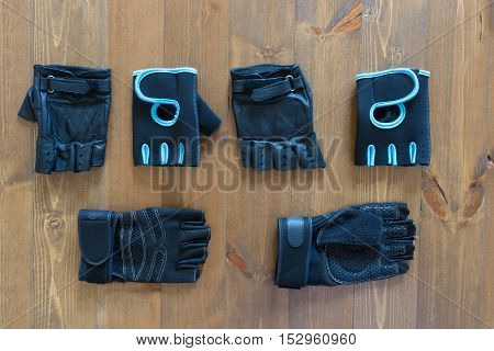 Three different pairs of gloves for fitness on the floor
