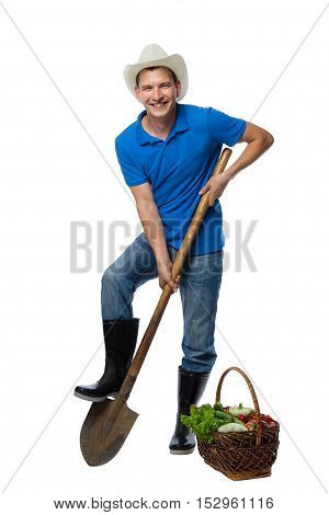 farmer with a shovel and harvest vegetables