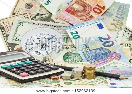 Calculator with coin pencil on money banknotes Euro and Dollarsconcept of business planning and finance and savings