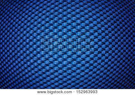 Blue convex synthetic fiber texture with vignette.