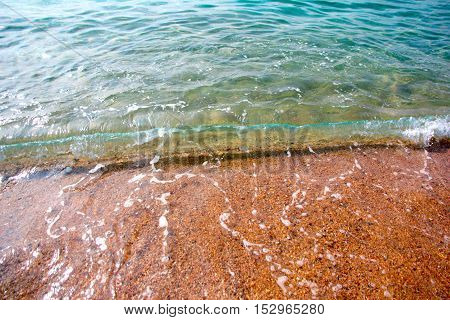 a beautiful sandy beach and a wave of the sea