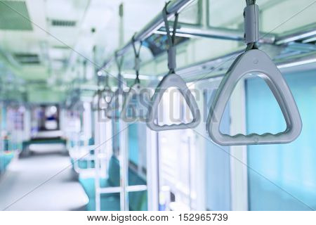 Image of handles in the public transportation