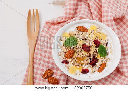 Bowl Of Mix Dried Fruits Muesli On White Background