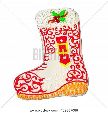 Christmas gingerbread in the form of boot isolated on white