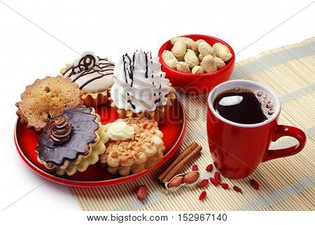 Different cakes in a plate and cup of coffee