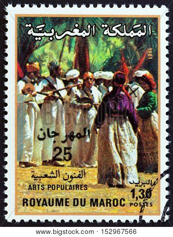MOROCCO - CIRCA 1981: A stamp printed in Morocco issued for the 22nd National Folklore Festival, Marrakesh shows folk musicians, circa 1981.