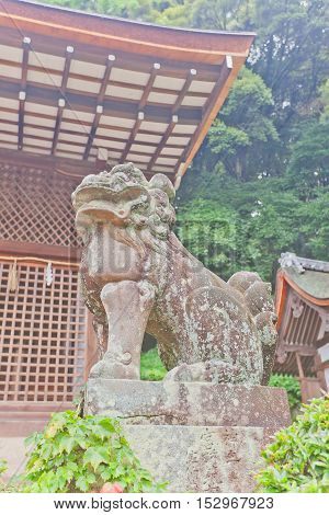 UJI JAPAN - JULY 27 2016: Komainu lion-dog guardian statue in Ujigami Shinto Shrine in Uji city near Kyoto. Ujigami Shrine was founded in 11th c. UNESCO site