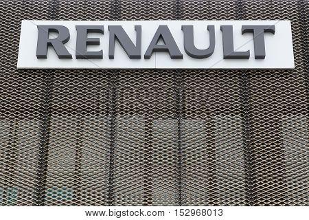Herning, Denmark - April 9, 2016: Signage at Renault car dealer's building. Renault is a french car manufacturer producing cars, vans, buses and trucks.
