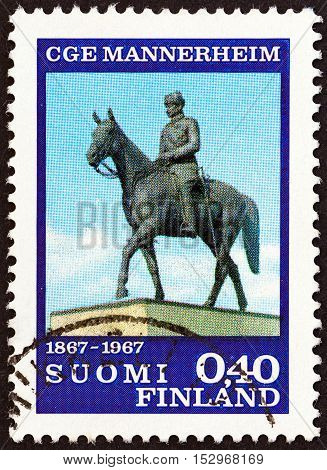 FINLAND - CIRCA 1967: A stamp printed in Finland issued for the birth centenary of Marshal Mannerheim shows Mannerheim Statue (A. Tukiainen), circa 1967.