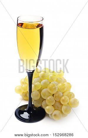 Ripe grapes and a glass of wine on white background
