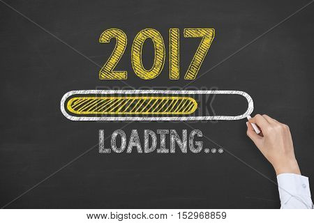 Hand Drawing Loading New Year 2017 on Blackboard