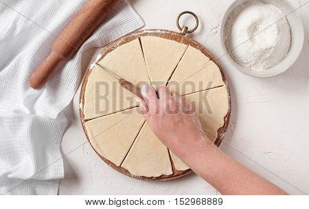 Women's Hands Cut The Dough