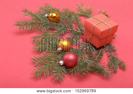 Christmas Composition With Gift Box And Light, Red Balls On Wooden Table