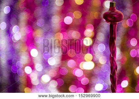 Old vintage icicle Christmas toy with beautiful bokeh background