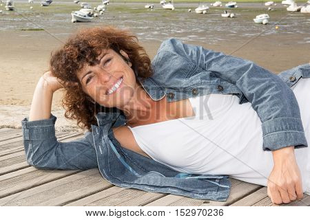 Portrait Of A Relaxing Woman On The Wooden Deck