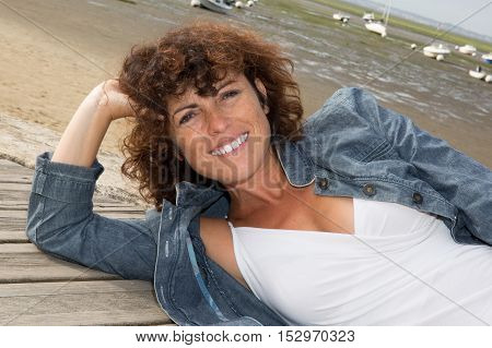 Woman Brunette Smiling At The Camera Relaxing