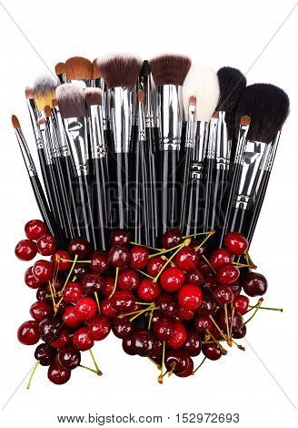 Cherries. Makeup brushes set. Isolated. White background.