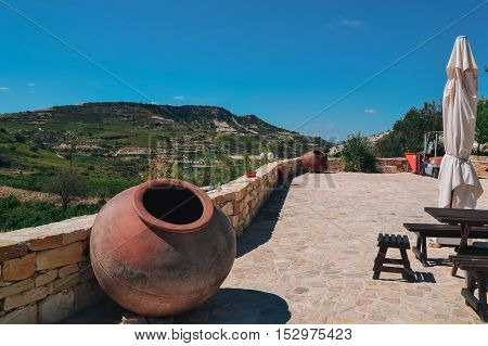 Big pitcher for decoration on the terrace restaurant. Large jug out of the wine or olive oil