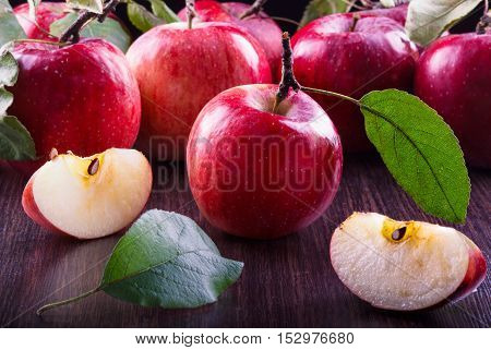 Ripe red apples on wooden background. still life