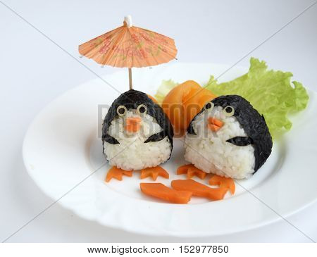 Penguins are made of rice. Creative food for good mood and appetite