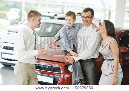 Automobile shopping. Family buying auto car