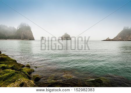 small islands in the fog off the Washington coast on the La Push Native American Reservation USA