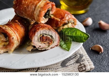 Pork Cutlets Wrapped In Bacon And Stuffed With Cheese, Spinach And Sun Dried Tomato