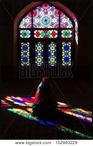 Iran Shiraz - September 2016: Persian girl in multi-colored mosque Nasir ol Mulk
