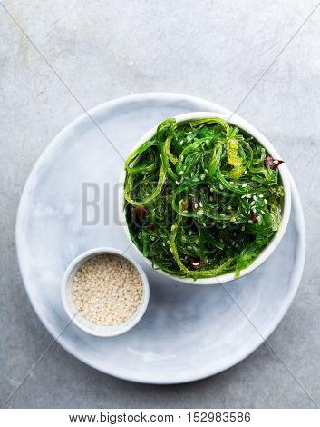Seaweed chuka salad with sesame seeds shot from above