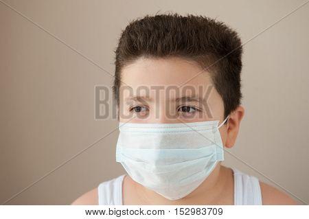 fat little boy wearing a medical mask