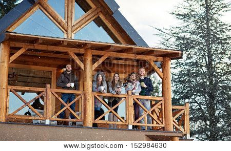 Young people enjoying in beautiful view from weekend house
