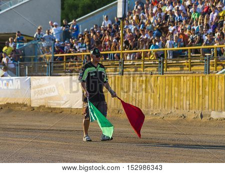 Rivne Ukraine - 29 August 2015 Referee prepares to launch a race at the Open Cup Speedway to the day of the city Rivne