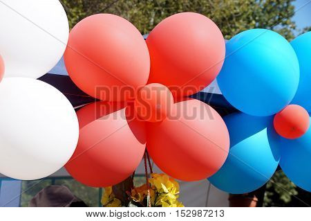 Big garland of multi-colored balloons in several colors